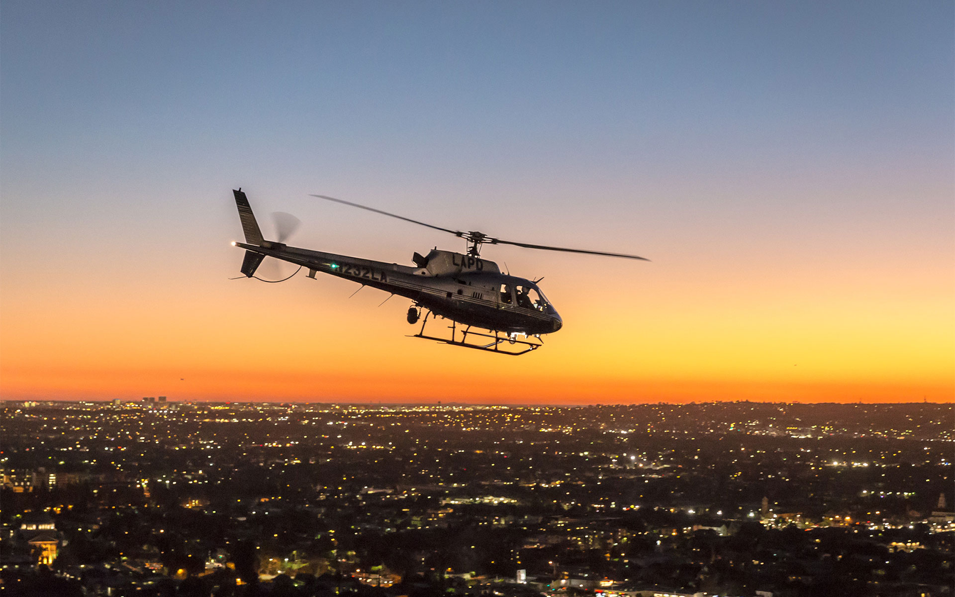 LAPD helicopter flying over Downtown. Los Angeles Helicopter Tours
