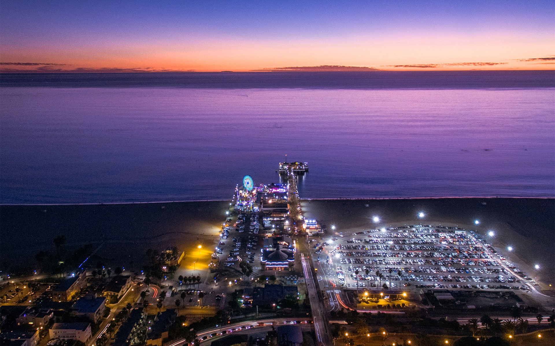 Santa Monica pier at sunset. Los Angeles Helicopter Tours