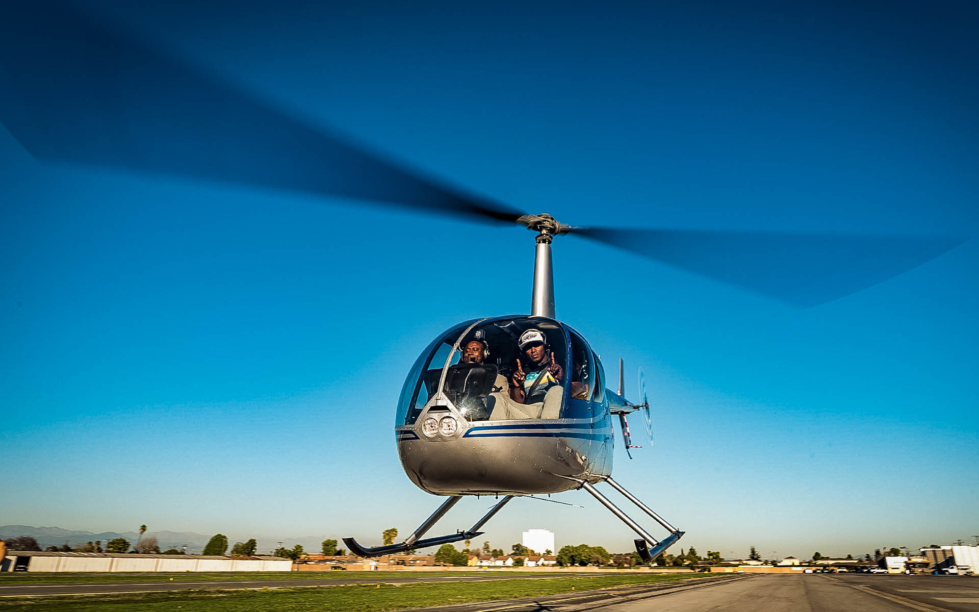 Robin flying the R22 with the Dodger's Yasiel Puig