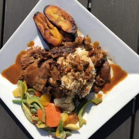 CURRY PORK WITH SEASONED VEGETABLE MEDLEY PLANTAINS AND SEASONED RICE