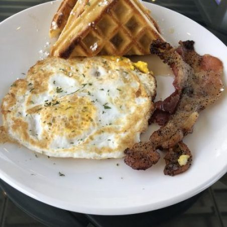 BUTTER BELGIUM WAFFLES WITH EGG OVER HARD, AND BACON